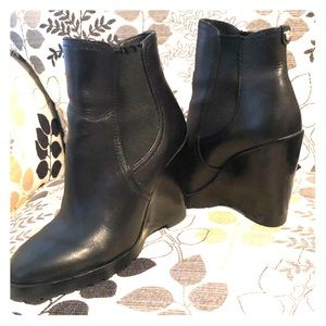 Michael Kors Thea leather wedge boots.